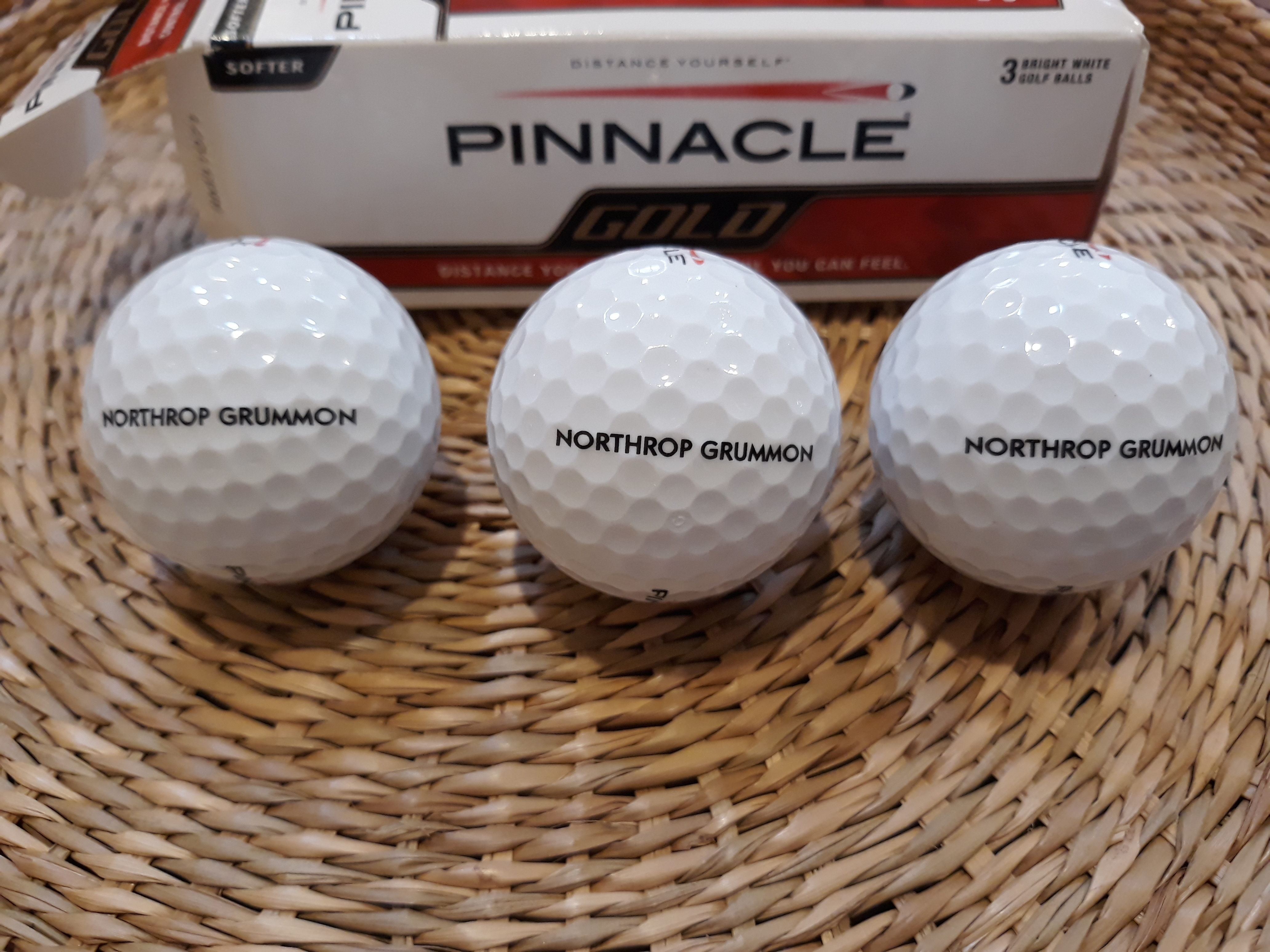 Golf balls with the name Northrop Grumman mis-spelled
